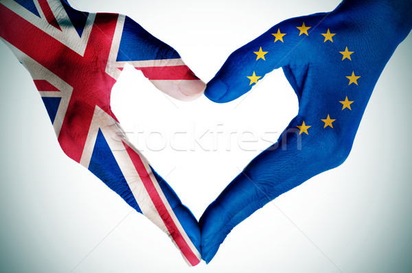 hands patterned with the British and the European flag forming a Stock photo © nito
