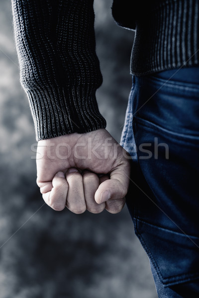 young man clenching his fist Stock photo © nito