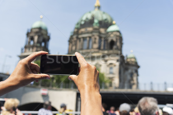 man taking a picture of the Berlin Cathedral