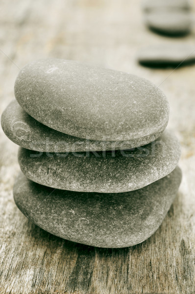 stones on an old wooden surface Stock photo © nito