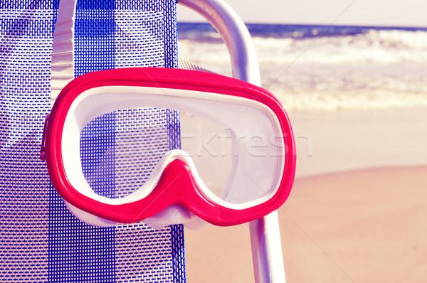 diving mask hanging in a deckchair with a retro filter effect Stock photo © nito