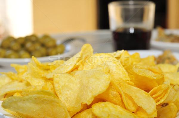 Chips ander voorgerechten plaat tabel Stockfoto © nito