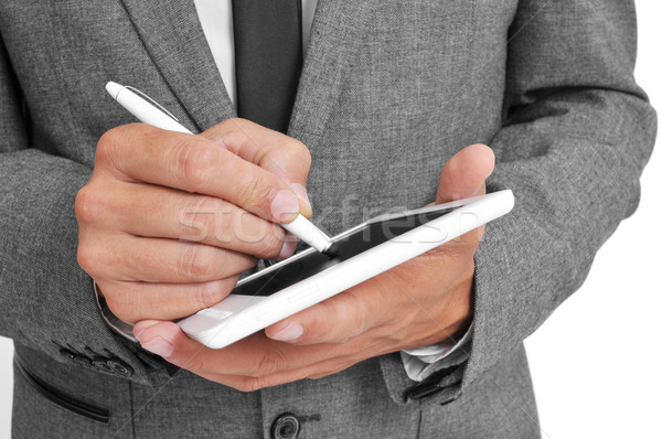 businessman using a stylus pen in his tablet Stock photo © nito