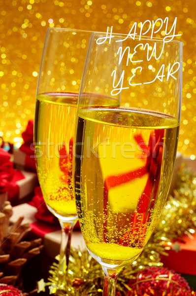 glasses with champagne and the sentence happy new year Stock photo © nito