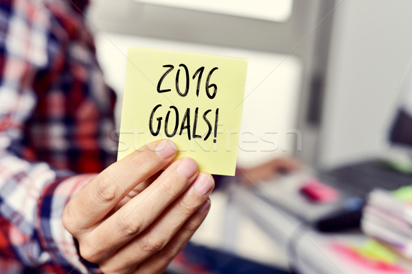 young man with a sticky note with the text 2016 goal Stock photo © nito