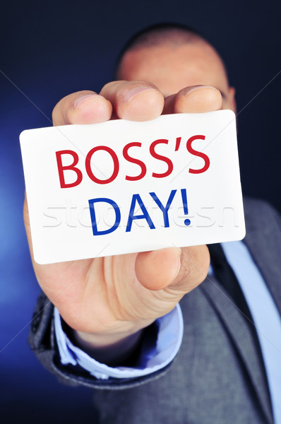man with a signboard with the text boss day Stock photo © nito