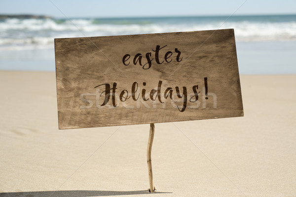 text easter holidays in a signboard on the beach Stock photo © nito