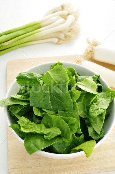 raw spinach, leeks and green garlics on the countertop of a kitc Stock photo © nito