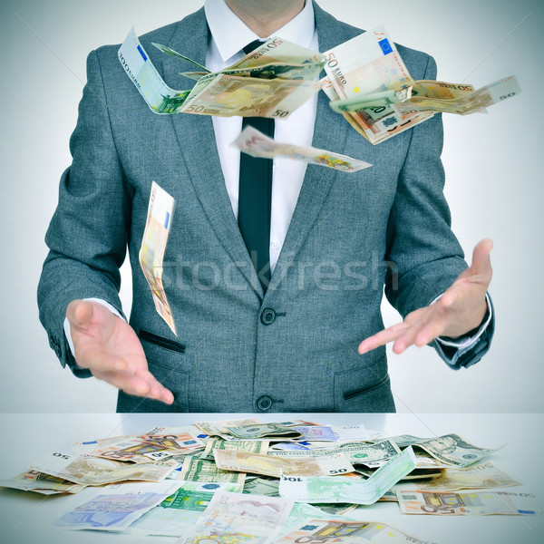 man trying to catch money falling from the sky Stock photo © nito