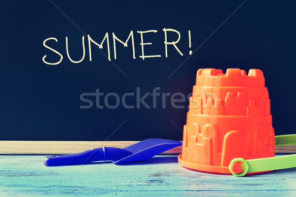 toy shovel and pail, and word summer written in a chalkboard Stock photo © nito