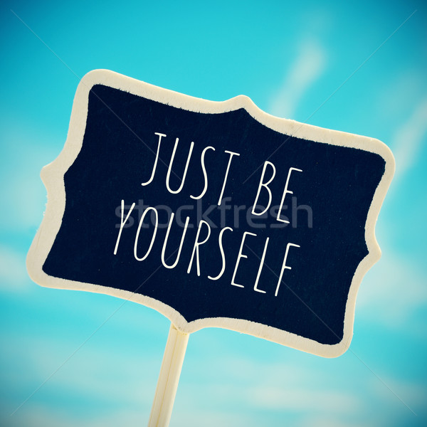 chalkboard with the text just be yourself, vignetted Stock photo © nito