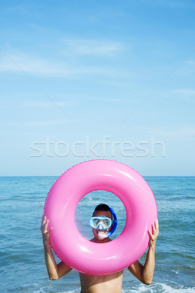 man on the beach with diving mask and swim ring Stock photo © nito