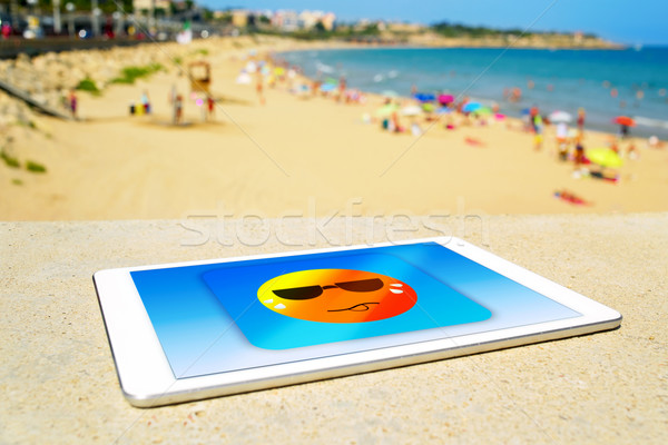 icon of a sun sweating in a tablet computer at the beach Stock photo © nito