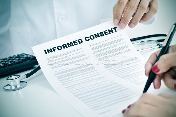 young woman signing an informed consent Stock photo © nito