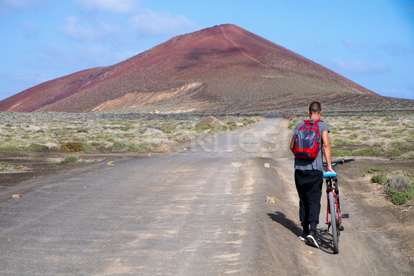 man with a bike in La Graciosa, Spain Stock photo © nito