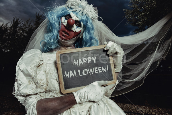 evil bide clown wishes you happy halloween Stock photo © nito