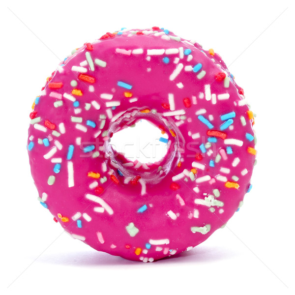 donut coated with a pink frosting and sprinkles of different col Stock photo © nito