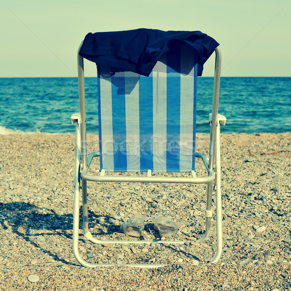 deckchair and man swimsuit on the beach, with a retro effect Stock photo © nito