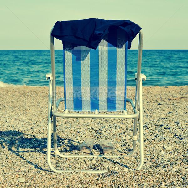 Espreguiçadeira homem maiô praia retro efeito Foto stock © nito