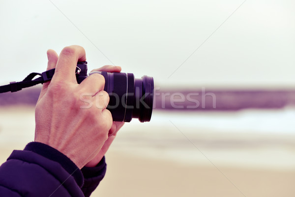 young man taking a picture in front of the sea Stock photo © nito