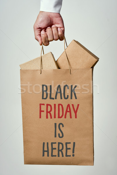 text black friday is here in a shopping bag Stock photo © nito