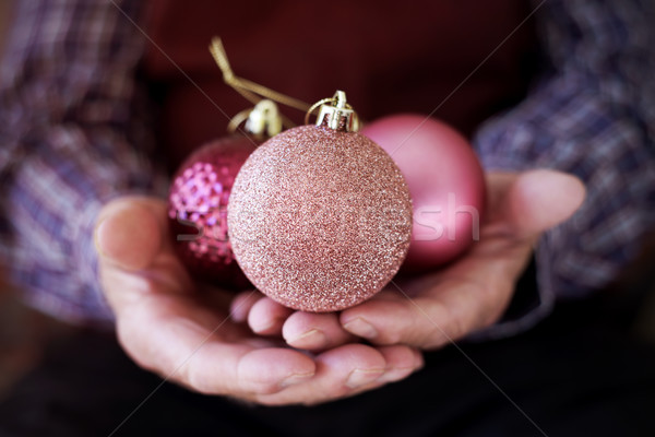 old man with christmas balls in his hands Stock photo © nito