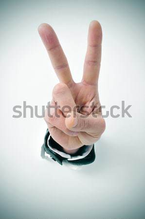 man hand giving the V sign Stock photo © nito