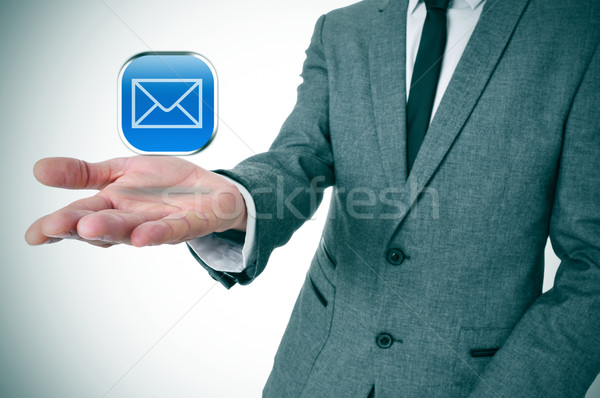 businessman with a message icon in his hand Stock photo © nito