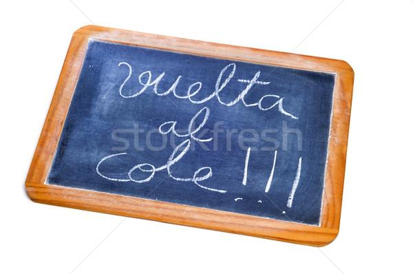 Vissza az iskolába írott spanyol iskolatábla fehér háttér Stock fotó © nito