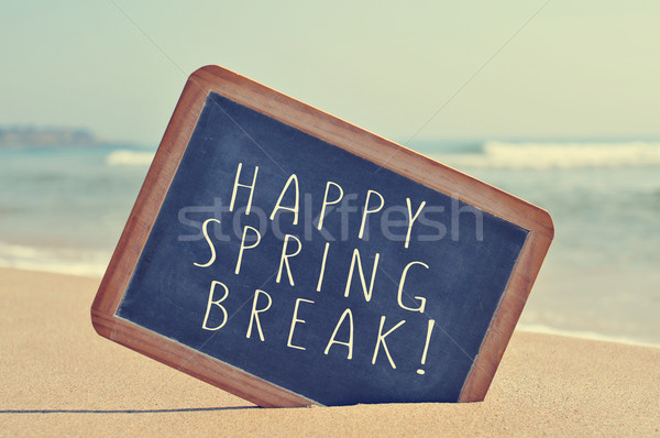 happy spring break in a blackboard on the beach, with a filter e Stock photo © nito