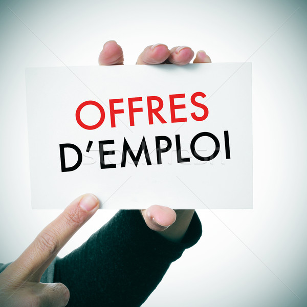 woman with a signboard with the text offres d'emploi, jobs in fr Stock photo © nito