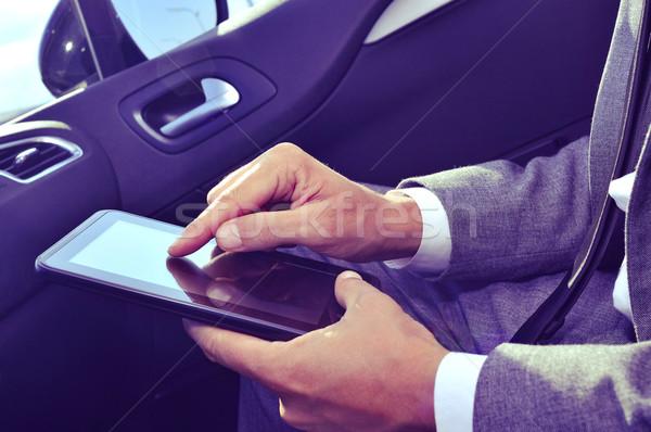 üzletember tabletta autó közelkép fiatal kaukázusi Stock fotó © nito