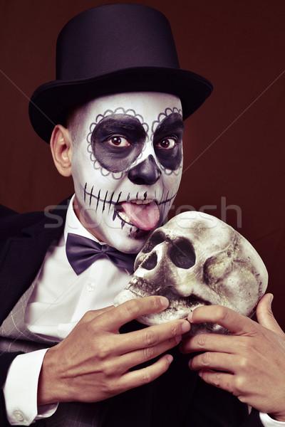 man with mexican calaveras makeup licks a skull Stock photo © nito