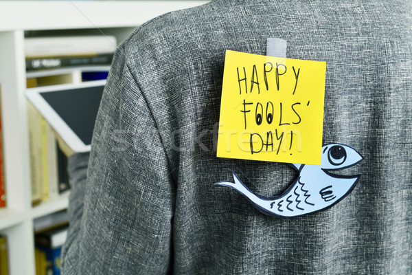 man with a note with the text happy fools day attached to his ba Stock photo © nito