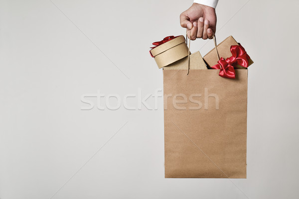 man with a shopping bag full of gift boxes Stock photo © nito