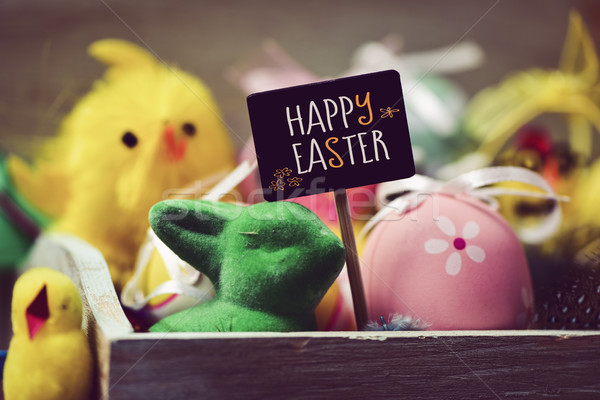 toy rabbit and chicks, easter eggs and text happy easter Stock photo © nito
