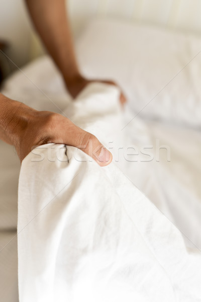 young man making the bed Stock photo © nito