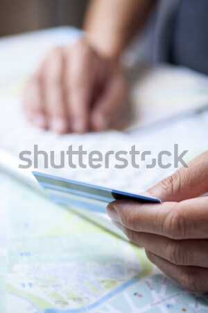 young man using a credit card to book a trip Stock photo © nito
