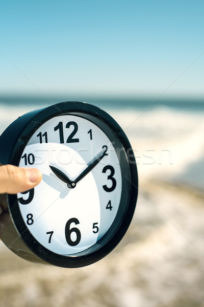 young man with a clock on the beach Stock photo © nito