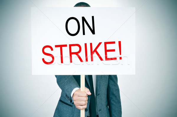young man in suit on strike Stock photo © nito
