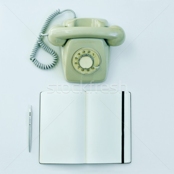 rotary telephone, pen and blank notepad on a table Stock photo © nito