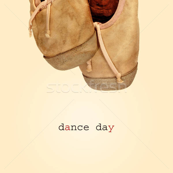 Stock photo: worn pointe shoes and the text dance day, with a retro effect
