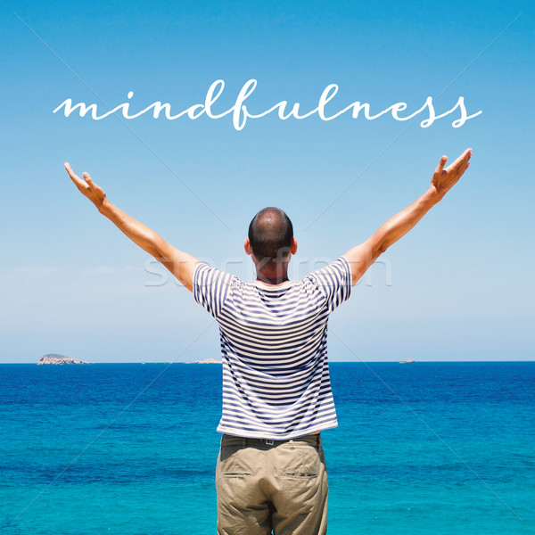 man saluting the new day and the text mindfulness Stock photo © nito