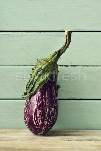 raw eggplant on a rustic wooden table Stock photo © nito