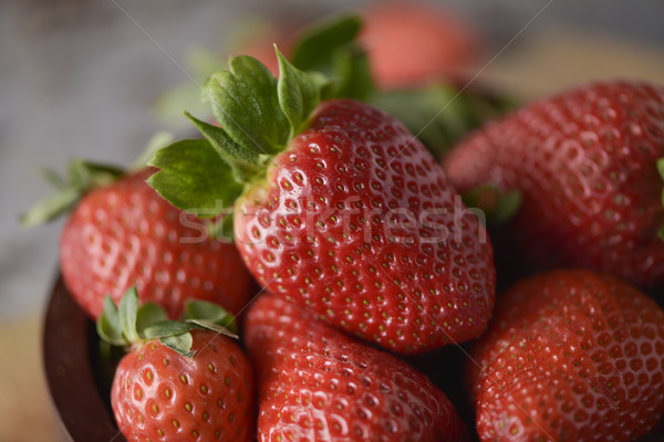 ripe strawberries in a wooden bowl Stock photo © nito