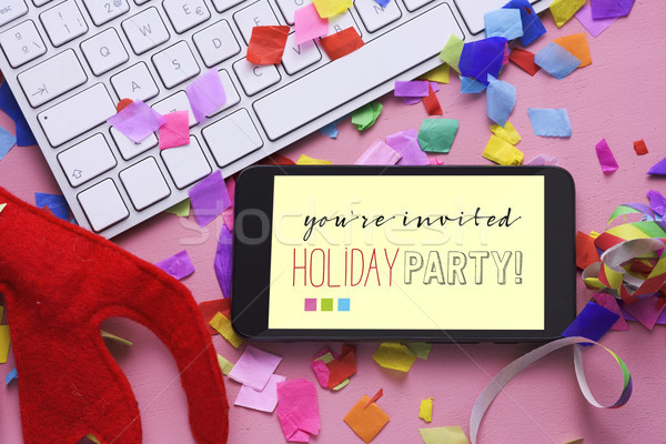 text you are invited holiday party in a smartphone Stock photo © nito