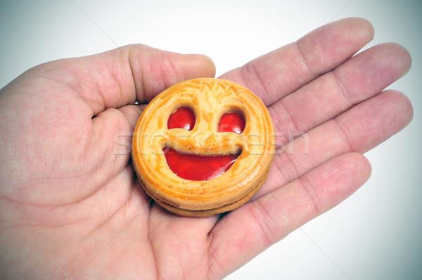 Emotikon keksz valaki mutat mosolygós arc kéz Stock fotó © nito