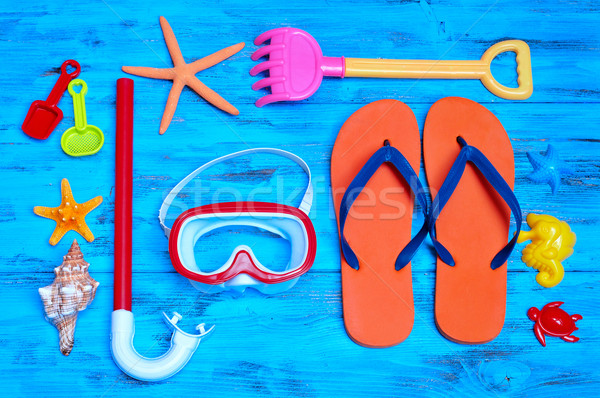 Stock photo: summer stuff, such as a pair of flip-fllops, a diving mask or a