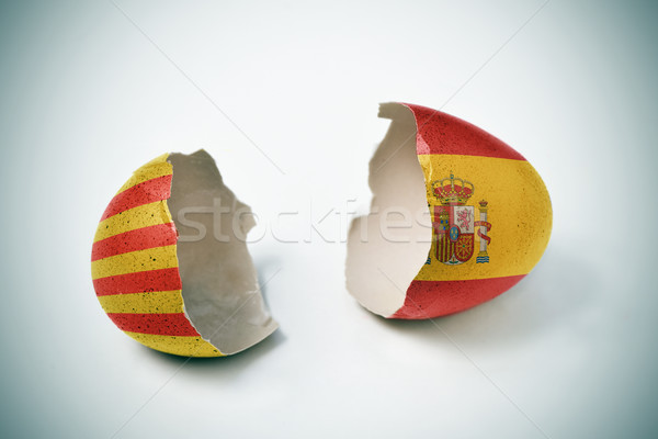 cracked eggshell with Catalan and Spanish flags Stock photo © nito