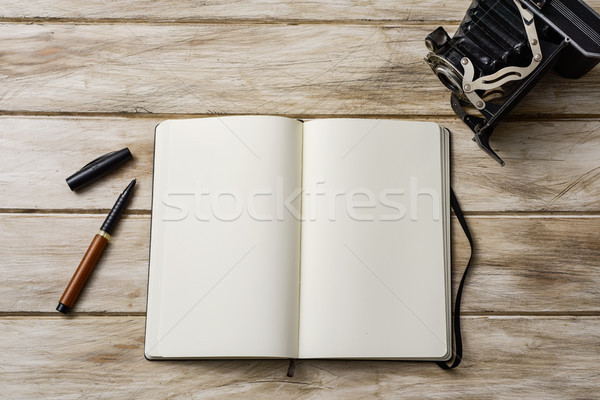 blank notebook, pen and old camera Stock photo © nito